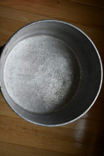 Set of five hammered aluminum saucepans