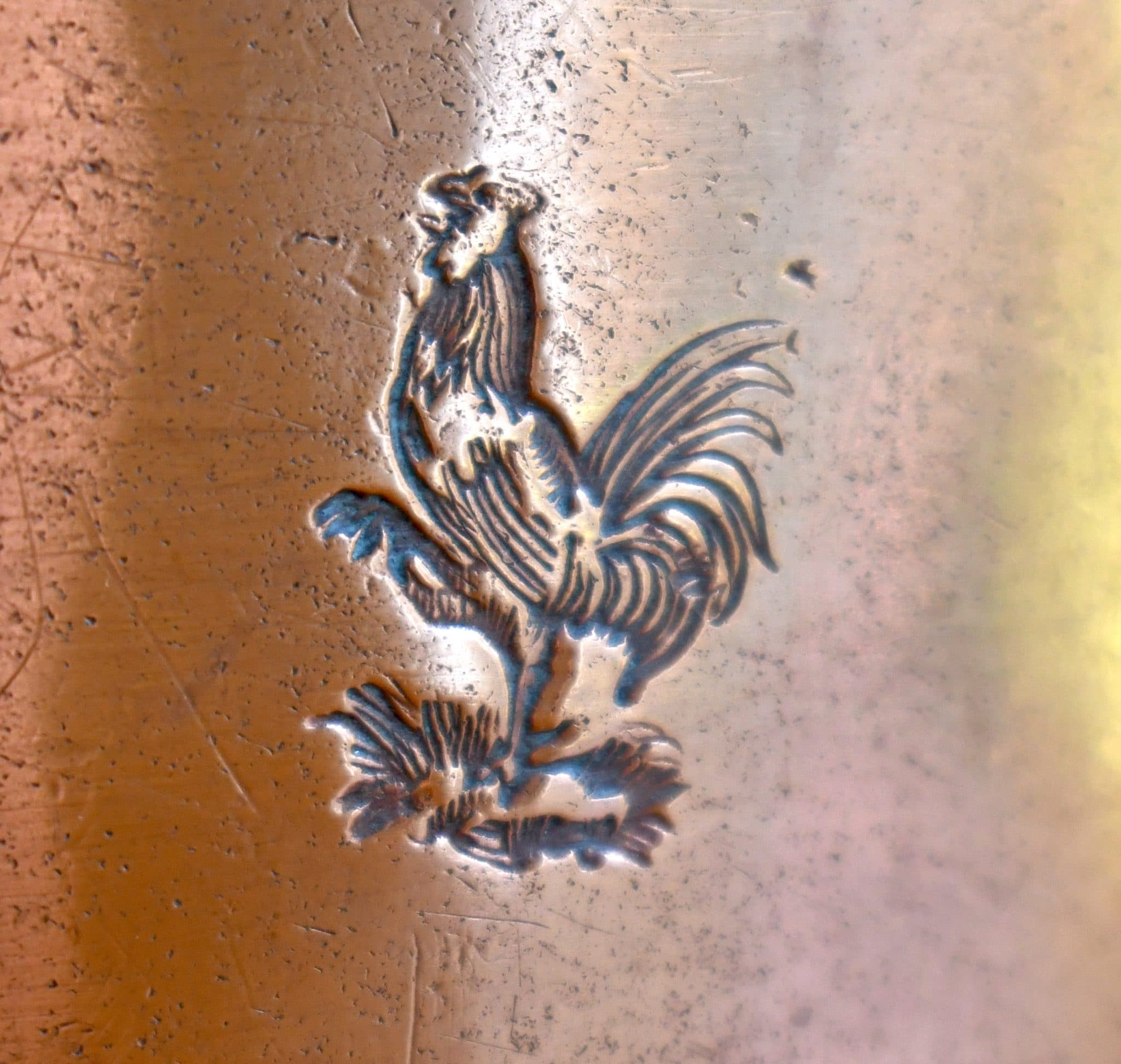 Scrollwork handles and the cockerel stamp